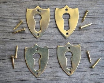 A set of 4 brass antique style Victorian furniture escutcheons SE2