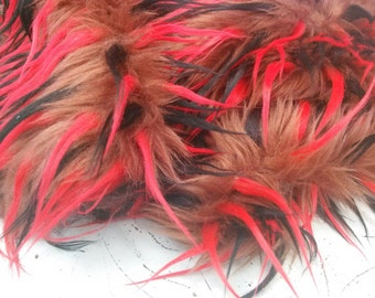 3 tone spikes faux fur fabric red black brown. Sold by the yard.