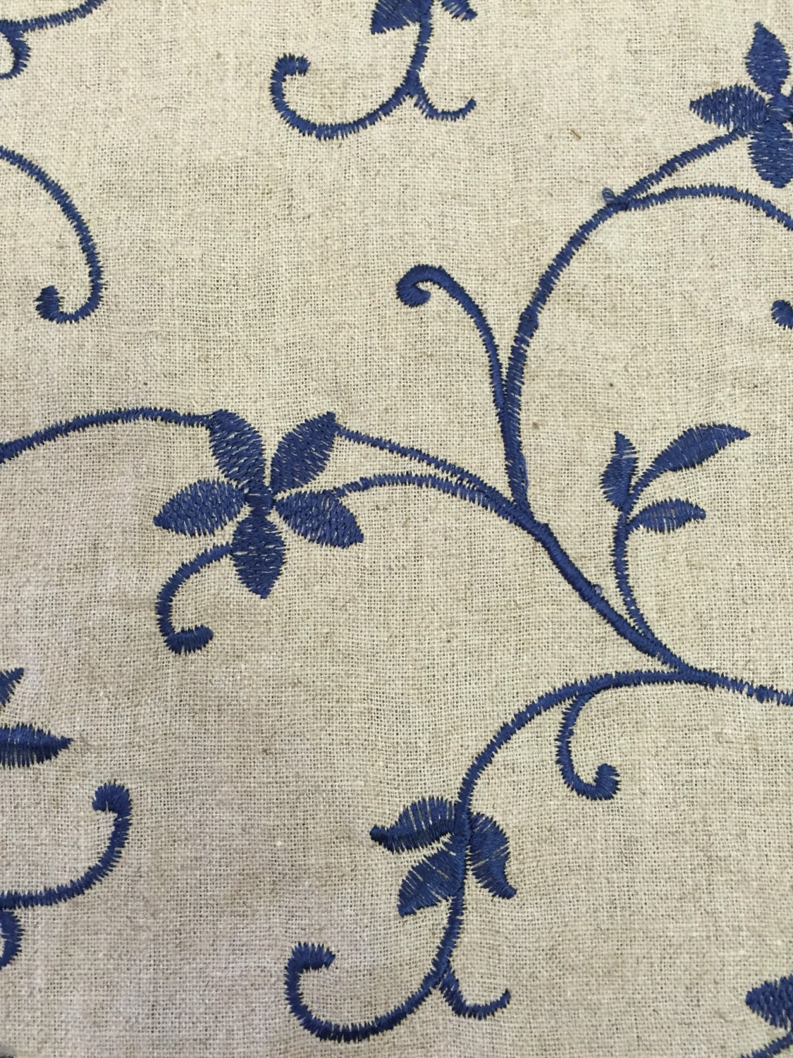 Navy embroidered vining floral fabric upholstery