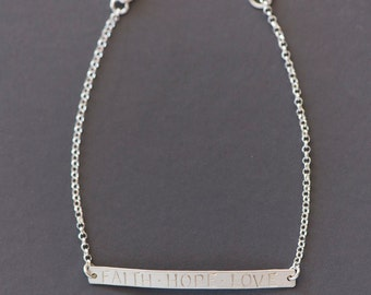 Stamped bar bracelet with the words faith/hope/love