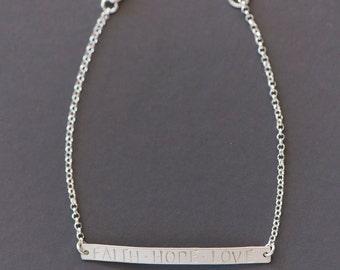 Faith Hope Love Bracelet/Stamped bar bracelet with the words faith/hope/love