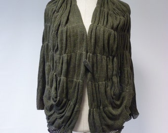 Sale, new price 70 Euro, original price 84 Euro. Forest green cardigan, XL size. Very artsy and fashion. Only one sample.
