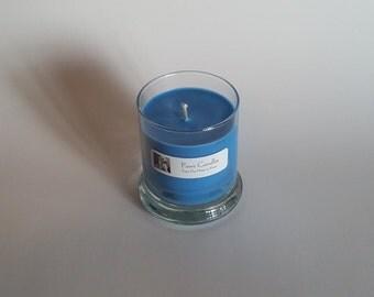 10oz Status Caribbean Teakwood candle.