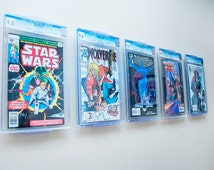 ComicMount - Comic Book Display - Wall Mount or Shelf Stand.  New Patented display product developed by ComicMount™