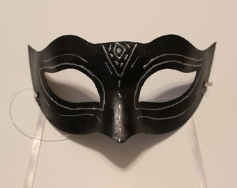 Black mask with silver design