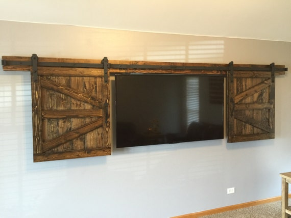 ideas to make a garage a family room - Hidden Sliding TV Barn Door Set Rustic TV Barn Door
