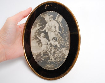 Antique oval religious picture, Angel with children, carton glass brass, in brass frame  (C0315)
