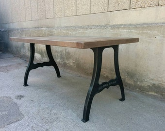 "Industrial aged oak dining table with distressed vintage finish on cast iron ""New York"" legs."