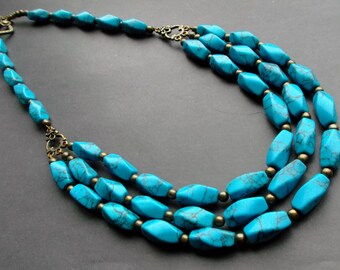 necklace dark turquoise. necklace three rows. necklace blue. necklace stones. turquoise blue. Gemstones. bronze details
