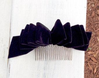 Velvet bow on hair comb