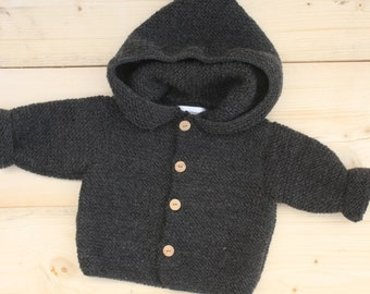 Vest with big hood and wooden buttons