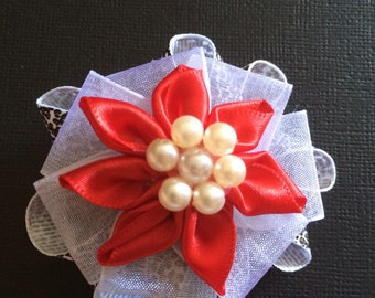 Pearly print in red hair clip.