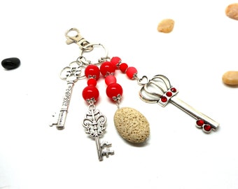 A scent! silver plated bag charm, key red beads