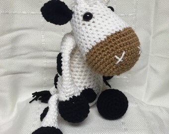 Crocheted cow snuggle buddy