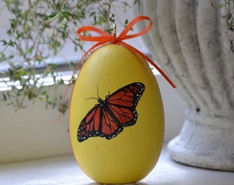 Pretty Monarch Painted on Wooden Egg.