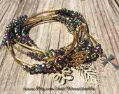 Iridescent Metallic Beaded Bracelet Set with gold plated charms-  Semanario pulseras de color metalico iridescentes con dijes chapa de oro