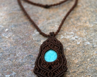 Handmade macrame pendant.