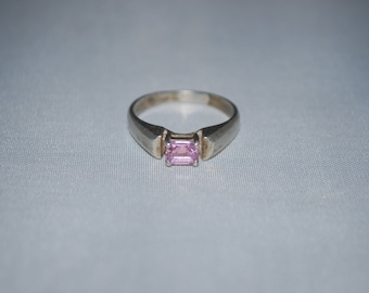 Sterling silver ring size 6.5 with amethyst setting.