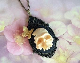 Human skull head and butterfly necklace