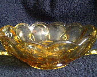 Anchor Hocking Fairfield Pattern Amber Dish. Double Handled Nappy Dish With Scalloped Edge And A Sunburst Pattern On The Bottom. 1972-1977.