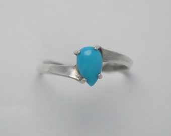 Native american turquoise ring and sterling silver drop shaped