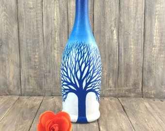 Blue painted bottle; painted wine bottles