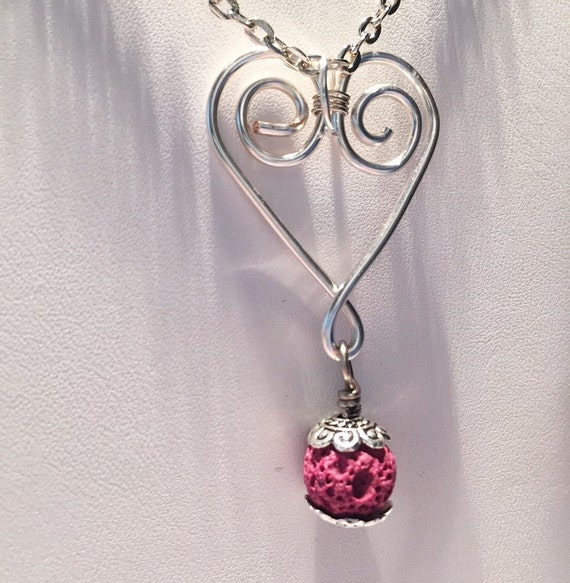 Swirling Heart Silver Pendant with Lava Stone Bead for Diffusing Essential Oil. Heart is hand-formed from sturdy gauge wire. Non Tarnish.