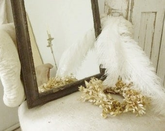 Antique mirror, stucco frame, dark gold, chippy, mirror glass with beautiful blind spots...CHARMANT!