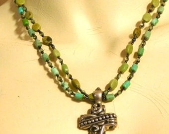 Southwestern style sterling cross and turquoise necklace
