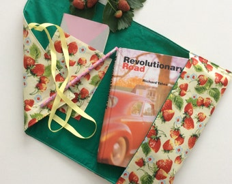 Book sleeve with strawberry print