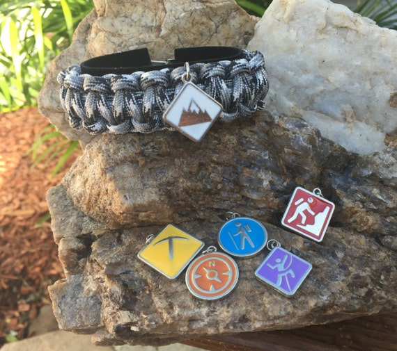 Mountain Sports Paracord Bracelet, your choice of 6 different charms, weaved onto a stainless steel silver metal buckle