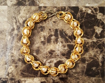 Captive Mother of Pearl Bracelet in Gold Tone