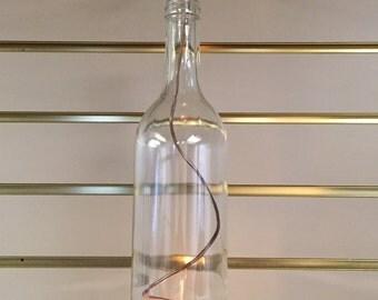 Wine bottle lantern- clear glass, welded copper wire bottom