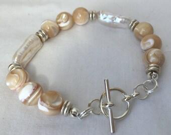 Golden lip shell (mother of pearl) beads & long white pearl bracelet