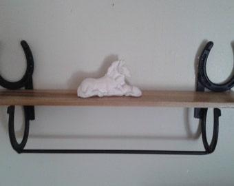 Horseshoe bathroom shelf with towel bar