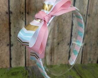 White gold, baby blue, and pink headband toddler/girl headband/woven ribbon covered headband/ arrow head design