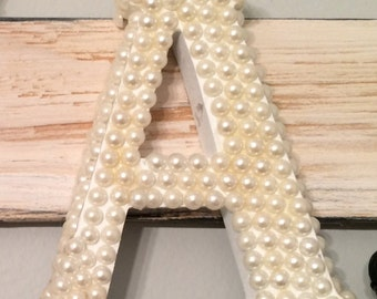 Wood letters with pearls