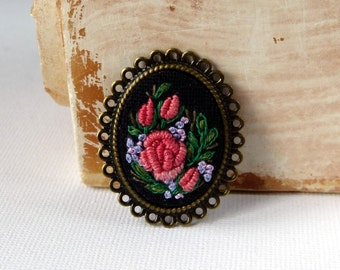 Hand embroidered brooch.