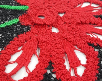 Crochet shawl with red flowers