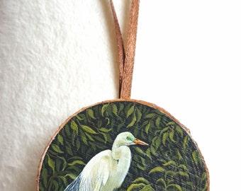 Miniature paintings on tree pane - little egret