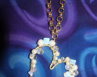 gold chain with heart adorned with Chinese, Opals, pearls and crystals