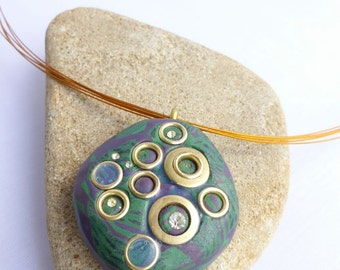 Necklace multi stranded wire decorated with pendants made from polymer clay and with circles