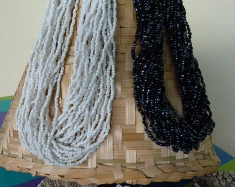 Necklace beads multi ranks, off-white or black silver reflection rock.