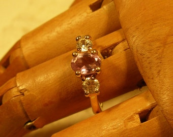 Beautiful faux amethest and clear rhinestone ring