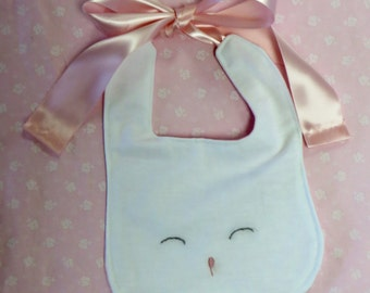 White Linen Embroidered Bunny Face Bib with a Thick Pink Satin Ribbon Tie