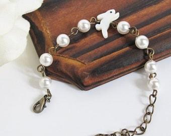 White Winter woodlands Inspired Bracelet. White Bunny Rabbit Shell Bead Swarovski Pearls Bracelet