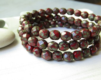 Red  Czech glass beads, faceted round  oval 6mm ,  opaque red  with  picasso edges  / 25 beads  6aZ129