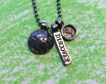 Discover necklace with compass and globe.