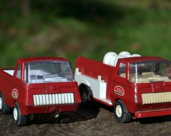 Pair of Red Tonka Trucks