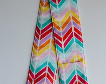 DSLR Camera Strap Cover with lens cap pocket and padding included - Chevron Bright